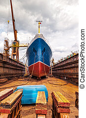 Ship in dry dock - Big ship at dry dock with its bulbous...