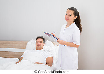 Doctor Holding Medical Reports Of Patient - Female Doctor...