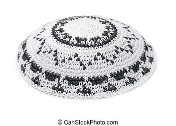 Yarmulke - White knitted jewish yarmulke isolated on white