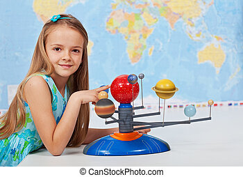 Young girl study solar system in science class - Young girl...
