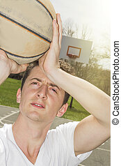 Shooting Free Throws - Young man shooting free throws from...