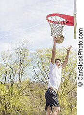 Basketball Fancy Layups - Young man doing basketball trick...