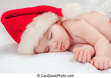 Small boy sleeping in a New Years cap - Sleeping cute baby...