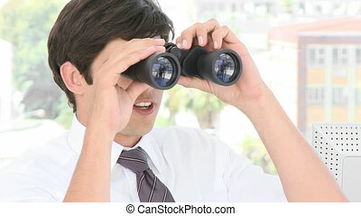 Young Businessman looking through b