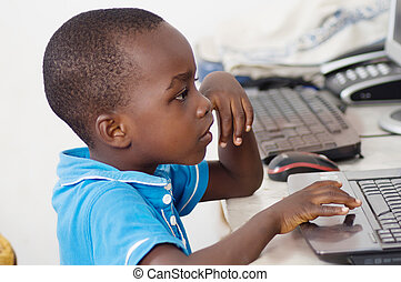 boy working on a computer.