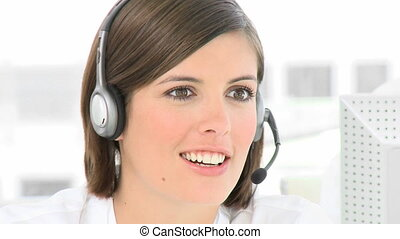 Businesswoman talking on a headset - Woman engaged in...