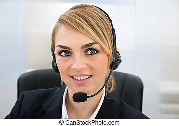 Smiling Female Customer Service Representative - Close-up Of...