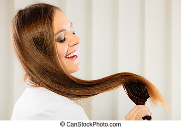 beautiful woman with long hair and brush - Health beauty and...