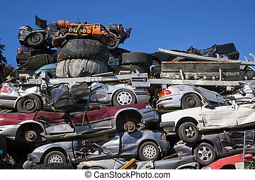Discarded Cars Stacked at Junk Yard - Low Angle View of Old...