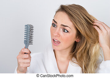 Worried Woman Looking At Comb - Worried Woman Suffering From...