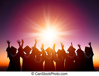 silhouette of Students Celebrating Graduation watching the...
