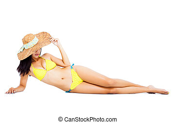 Full length beautiful young woman posing in bikini