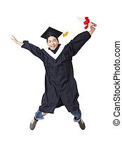 Happy student in graduate robe jumping against white...