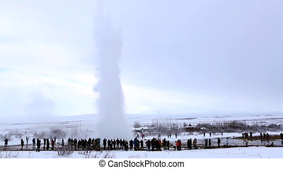 Visitors at the geyser eruption in Iceland