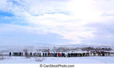 Visitors at a geyser eruption - Visitors at the geyser...