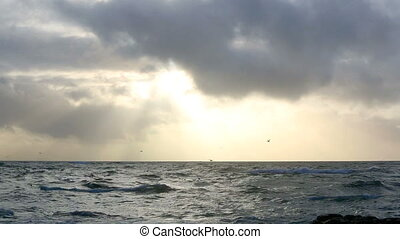Waves of the Atlantic Ocean with dramatic clouds