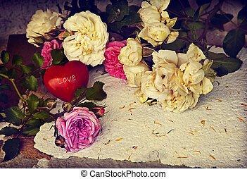 Beautiful flower background with roses, little red heart and...
