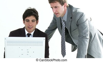 Two young Businessmen working toget