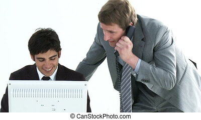 Young colleagues helping each other - Two young Businessmen...
