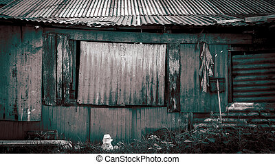 Thai style house in slum - rusty metal wall background, old...