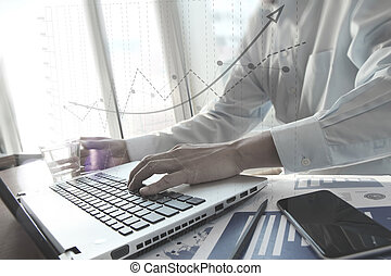 business documents with smart phone on office table and...