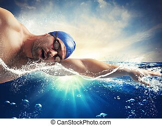 Sunshine swimmer - Swimmer swims in the sea in sunshine