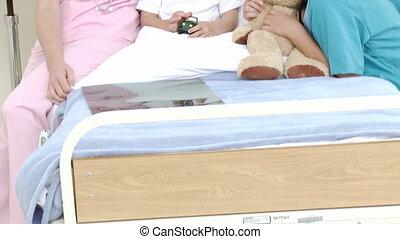 Little boy in hospital - Little boy in a hospital bed in...