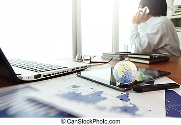 business documents on office table with texture the world on...
