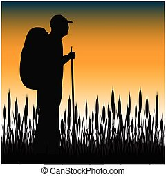 Tourist in field - The Silhouette of the tourist with...