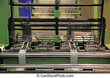 textile industry - Machine for knitting textile tape on two...