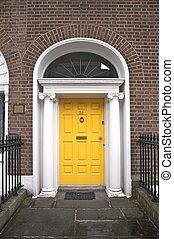 yellow classic door - classic door typical of dublin in...