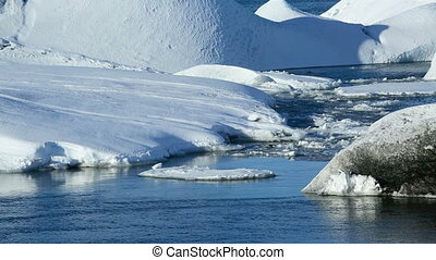 Ice floes melting at a glacier lago - Ice blocks melting at...