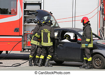 firefighters and relieve the injured in car after road...