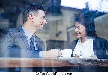 Businesswoman and businessman having coffee break - Happy...