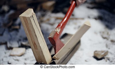 Forester chopping wood with an axe close up slow motion -...