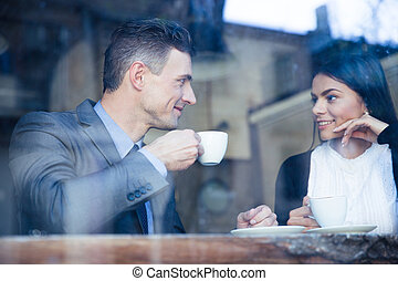 Happy couple drinking coffee in cafe - Happy young couple...