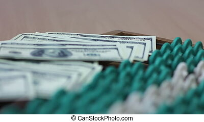 dollars on abacus (rack focus)