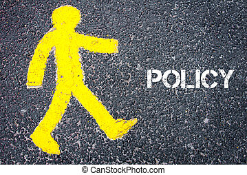 Yellow pedestrian figure walking towards POLICY