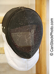 Fencing mask with the traditional fine wire mesh