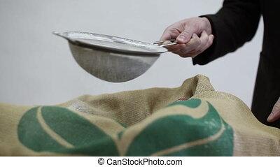 man sifts flour