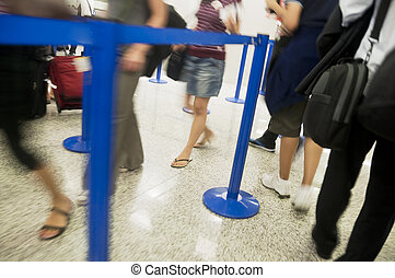Airport Queue - Airline passengers in a queue; queue moves