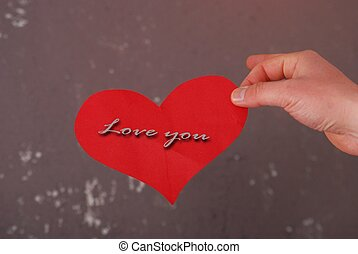Man hand hold love you card - picture of a Man hand hold...