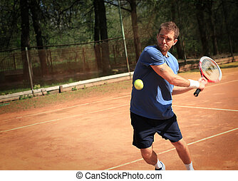 Tennis, player strong punches the ball with a racket