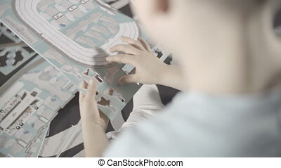 child press detail in toy pattern ungraded close shot -...