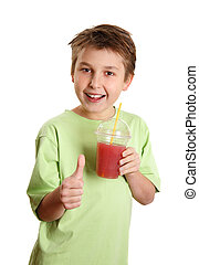 Healthy boy drinking juice thumbs up - A happy, health...