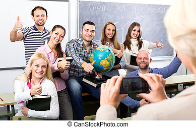 Teacher taking a photo of students