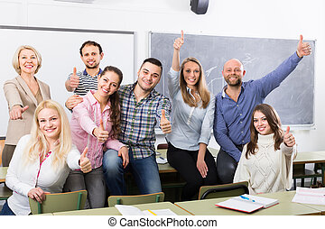Portrait of adult students at class - Cheerful smiling adult...