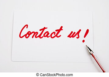 Contact us handwritten on a white paper with a red pencil