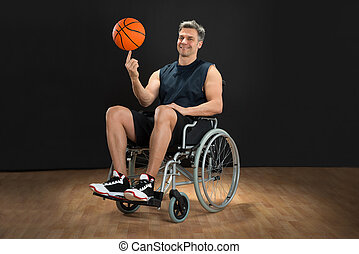 Disabled Basketball Player Spinning Ball