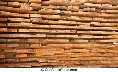 Wooden timber at a sawmill stacked and ready for sale